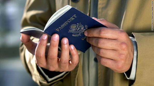 American holding passport.