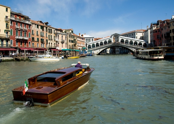 The famous Rialto Bridge and canals of Venice in Italy