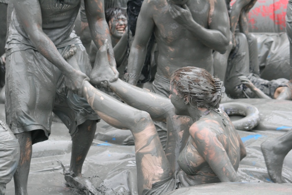 People playing in mud, Boryeong, Korea, one of the bizarre, weird festivals around the world