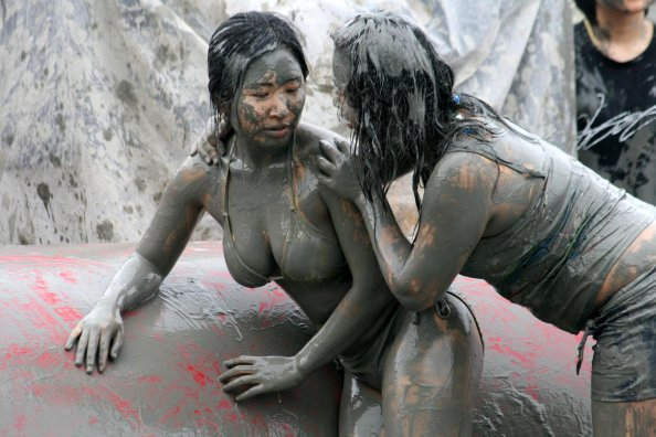 Mud covered girl at the Boryeong mud festival in Korea