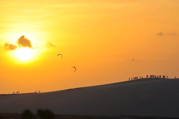 Sunset over the sand dunes near the ocean  Jericoacoara, Brazil